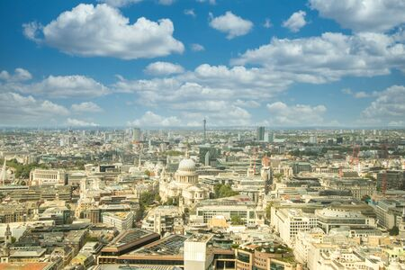 A typical view of the famous London skyline and it's huge buildings that engulf the area filled with businesses and apartments.