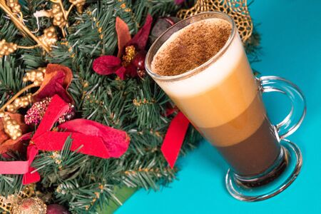 A specially made festive coffee, against a bright blue background.