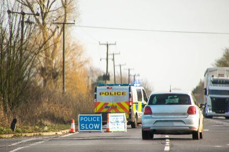 Police have coned off a lane of a busy main road, in the United Kingdom, to prevent any further accident.