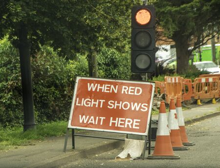 Typical British traffic lights to control traffic in calm or busy areas.