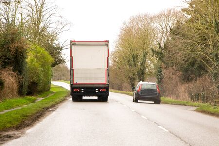 A dangerous overtaking manoeuvre into oncoming traffic.
