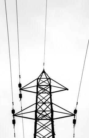 A typical electricity pylon in the United Kingdom. These steel structures hold thick cables that transfer electricity across the land.
