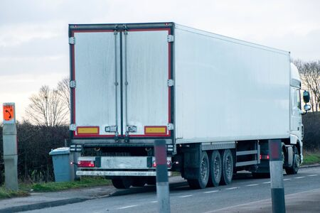 A large HGV travels across country to deliver or collect goods for the next business location.