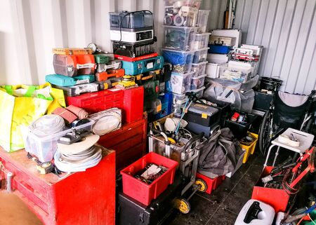 A storage container full of household items. Stored safely away. Stock fotó