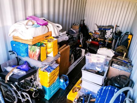A storage container full of household items. Stored safely away.