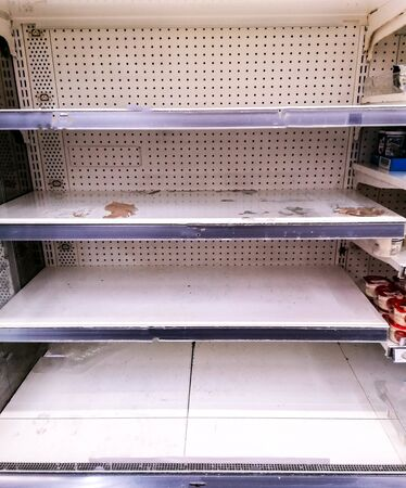Shelves sit empty after the panic buying due to the worldwide pandemic Coronavirus scare.