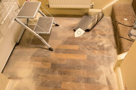 A large amount of dust that has accumulated from sanding down walls and wood.