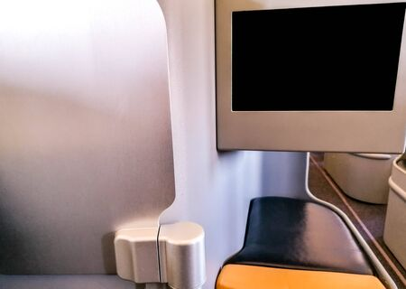 A large seating pod on-board a passenger aircraft, with plenty of leg room. Standard-Bild