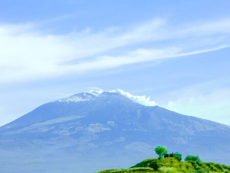 One of the most active volcanoes in the world seen here smoking after a large eruption. This is Mount Etna, located in Sicily, Italy.