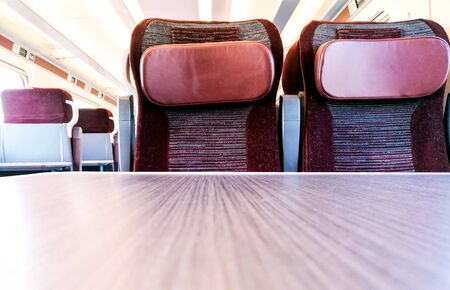 A view along the many rows of empty First Class seating onboard a train. No passengers or staff seen onboard, due to the pandemic. Standard-Bild