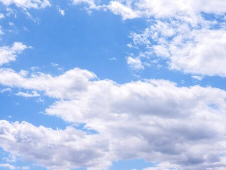 A full frame of summer clouds, fluffy, big and small against a blue sky. Standard-Bild