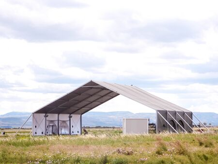 A large and empty aircraft hangar, opened at both ends. This provides protection for stored aircraft. Standard-Bild