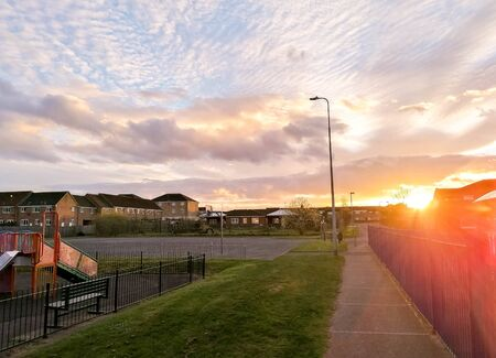 A beautiful sunset behind a primary school fence boundary. Standard-Bild