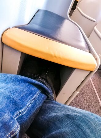 A large seating pod on-board a passenger aircraft, with plenty of leg room. Reklamní fotografie