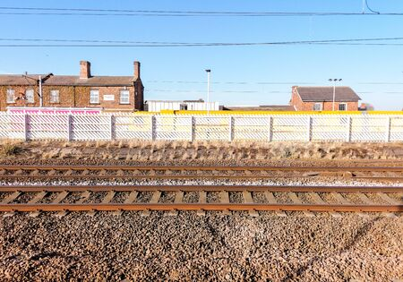 A of several railway tracks from a platform in the United Kingdom.