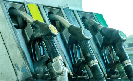 A view across petrol and diesel pumps at a gas station. Standard-Bild