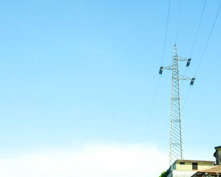 Just one of the thousands of pylons in Italy that take electrical energy to households and businesses across the country. Taken on a blue sky.