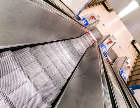 A photo looking down an empty escalator in the London Underground during the Pandemic. Imagens