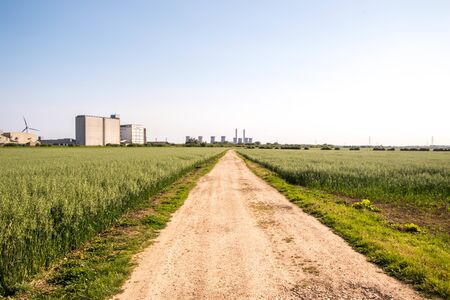 Flat land with a track that leads through the beautiful countryside of the United Kingdom.