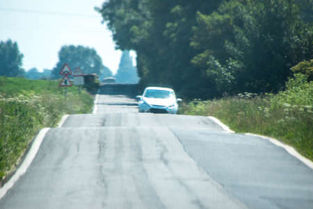 One of the many dangers from driving, Blind Summits impairs vision for drivers trying to concentrate on other traffic passing them.
