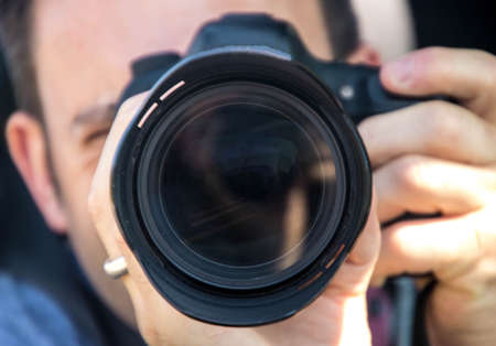 A look down the lens of a photographer with a DSLR.