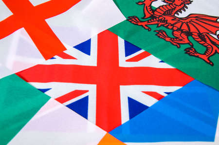 Flags piled upon each other from the United Kingdom.