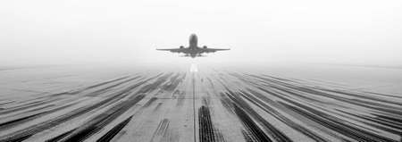 A view of a runway at one of the UK's largest growing airports. A passenger airline taking off towards the camera.