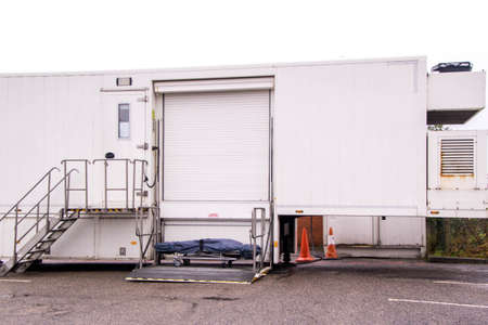 A large mobile scanning unit housed in the back of an articulated lorry trailer, used for health service patients.