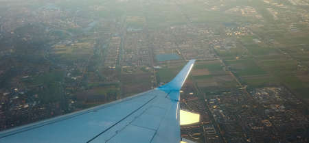 A view from a passenger window of a large aircraft traveling across the world on a holiday or business trip.