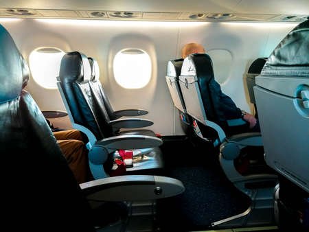 A view along one of the rows on board an airline. The seats empty due to the lack in travel with the virus pandemic.