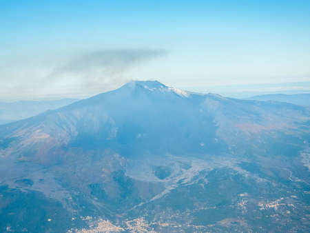 One of the world's most famous landmarks and also one of the most active volcano on the planet, Mount Etna sits emmiting smoke and ash on the island of Sicily, Italy. Foto de archivo