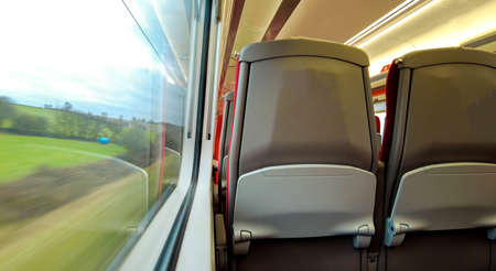 A passenger view onboard a train crossing the United Kingdom via the network of mainlines going city to city.