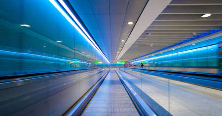 A view from one of the flat travelators that take passengers quicker along the long walkways, within a terminal in a large airport,