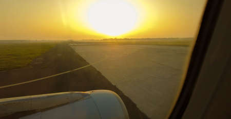 A passenger view from onboard a passenger aircraft of an airport area before the plane departs or just after it has arrived.