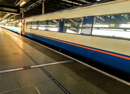 A view on just one of the thousands of train stations platforms in the United Kingdom. Stock Photo