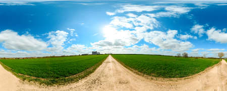 A walk along the open land of the British Countryside, during spring time with the sun shining. The land flat and open for miles to see all around.