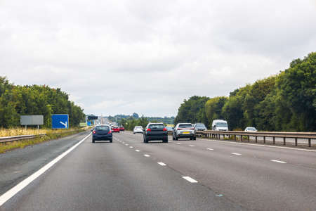 A view from a passenger seat of a vehicle traveling along a motorway in the United Kingdom.