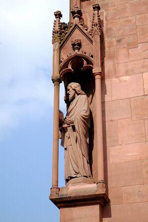 sain: Sain Statue on the Basel Munster wall Stock Photo