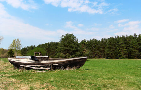 middle ages boat: The old wooden boat laying in the field