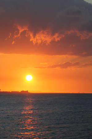 the color of silence: The bright red sunset at the ocean Stock Photo