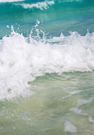 leasure: The wave with foam at the shore of the ocean Stock Photo