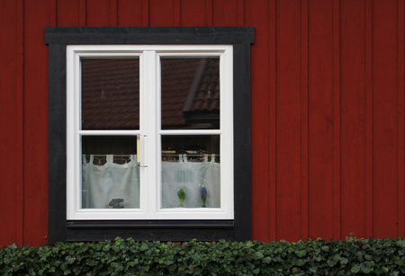 white window: The white window in the old red wooden wall Stock Photo