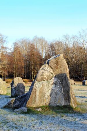 tumulus: The big stones standing in the snow field in winter