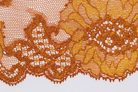 materia: The macro shot of the orange and brown lace texture materia Stock Photo