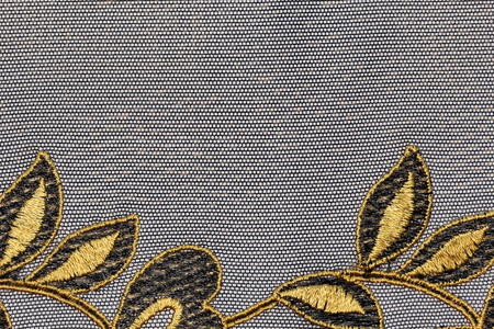 gold lace: The macro shot of theblack and gold lace texture material