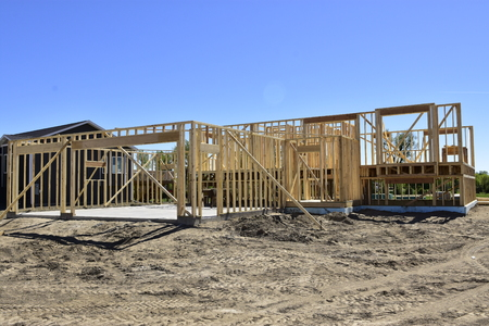 Single family wood frame home under construction.