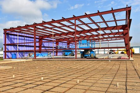 Steel frame commercial building under construction. Stock Photo