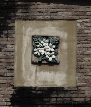 Flowers on a brick wall