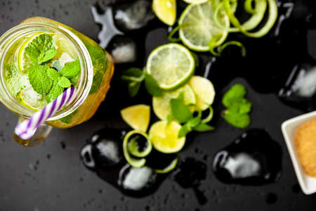 Mojito set. Lime brown sugar and mint leaves on a concrete slab. Space copy Stok Fotoğraf