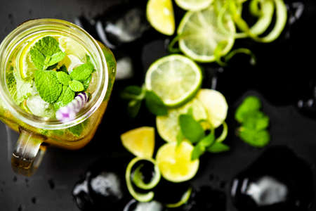 Mojito set. Lime brown sugar and mint leaves on a concrete slab. Space copy.